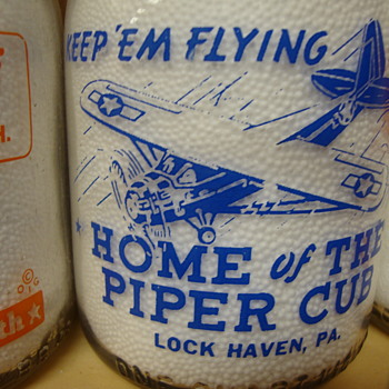 Superior Dairy..Lockhaven, Pa. with a PIPER CUB AIRPLANE war slogan design..... - Bottles