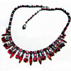 SIGNED SHERMAN NECKLACE IN SIAM RED COLOURS, JAPANNED BACK