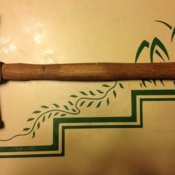 Delicate hammer with green head and elongated nose...