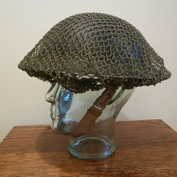 British WWII late war cammo helmet.