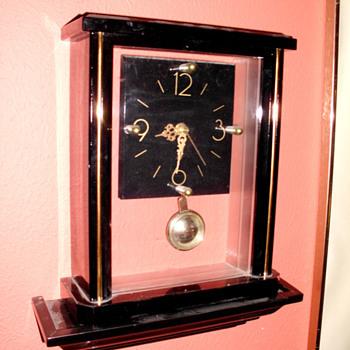 Clear Art Deco Clock on Shelf