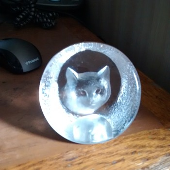 A Cat Face paperweight with an etched signature and number, not easy to read M Y Swellm 9176
