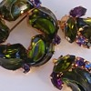 Brooch and earclips in wonderful foiled green glass and purple rhinestones