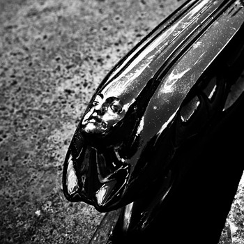 Mysterious Hood Ornament - Classic Cars