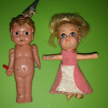 Two tiny dolls