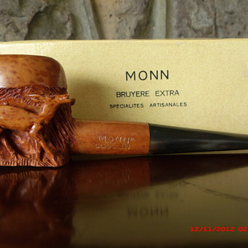 A very nice hand carved pipe with three deer carvings.