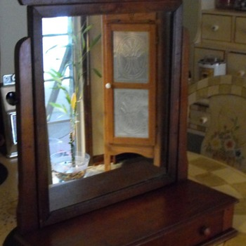 Antique gentlemans adjustable shave dresser mirror.  Need help to Identify??
