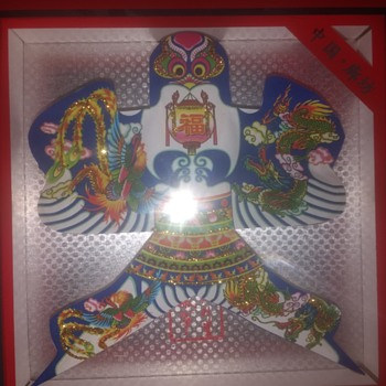 Found in the same Charity shop today. Chinese art minature kite in case, stunning design very colourful