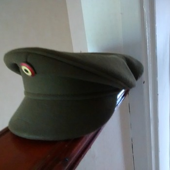 Military Green Officer's peaked cap, with a badge, marked inside A B L Seymour 1965 Kortruk T&H 23923, 55