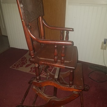 My moms handmade wooden rocking chair/high chair