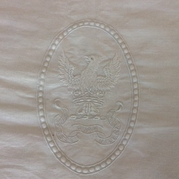 Damask linen with insignia