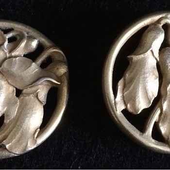Two silver gilt buttons