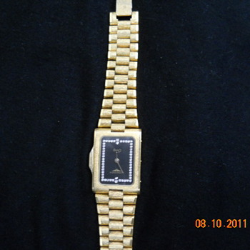 I am trying to find a value on this gift.  It is a Longines quartz