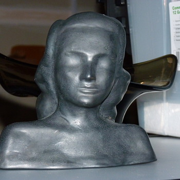 Bust of young girl, 40's or 50's pottery thick black/gunmetal glaze.  - Pottery