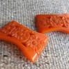 Orange bakelite clips