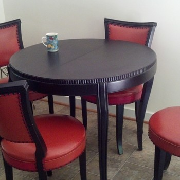 Black stained wood table and leather chairs