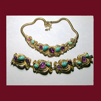 One of my favorites is this fabulous faux turquoise and amethyst demi. Signed BOUCHER