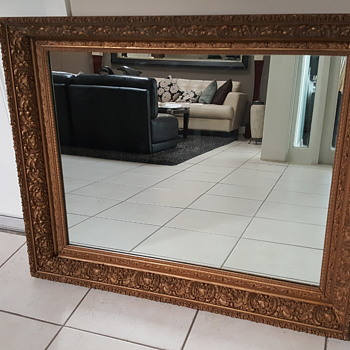 Intricately carved framed mirror