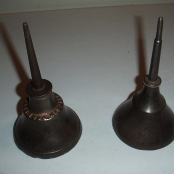 a pair of cast iron oil cans (1884 pat. date)