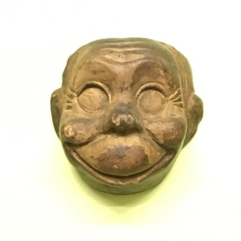 Cast iron comical face. Who is it??? - Fine Art