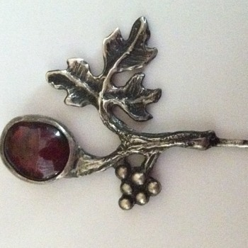 Silver and garnet pin, marked GJ.