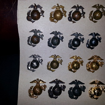 collection of Eagle Globe and Anchor US MARINE CORPS cap badges (e.g.a's) WWI to today