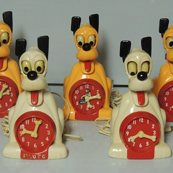 PLUTO ELECTRIC ANIMATED CLOCKS - Clocks
