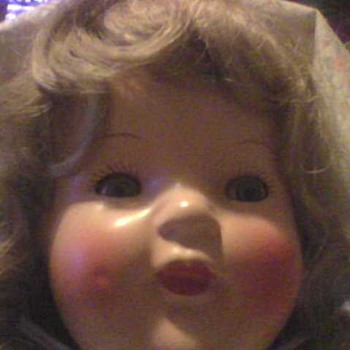 A PRETTY TIN SLEEP EYES DOLL