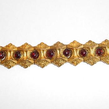 Gilt Segmented ornate red stone costume bracelet