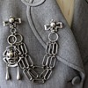 Sterling double clasp swag brooch w/Arts & Crafts motif
