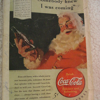 1940 ADVERTISING SANTA CLAUS DRINKING A BOTTLE OF COKE.