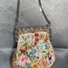 Can anyone help me identify this vintage embroidery purse?