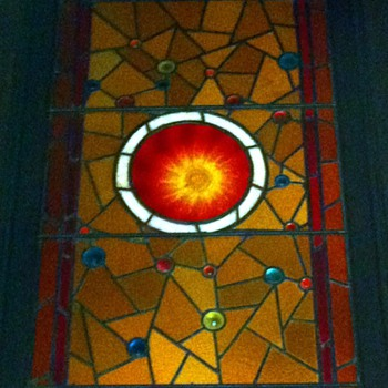 leaded multi-colored bullseye stained glass window from childhood home