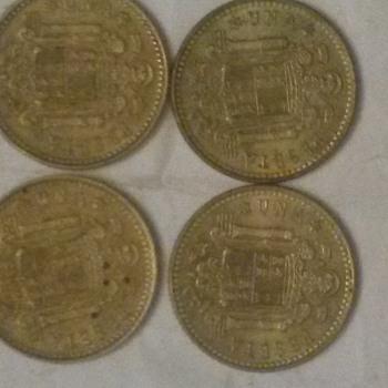 una peseta coins