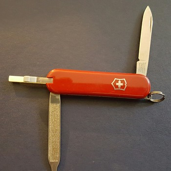Two Victorinox and one Wanger Delemont knife.