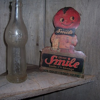 Vintage SMILE orange drink countertop stand up poster and bottle - Advertising