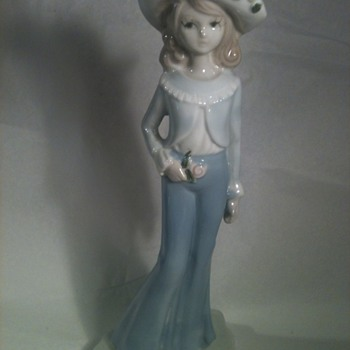 A PORCELAIN GIRL WITH BIG PANTS AND BIG HAT . - Pottery