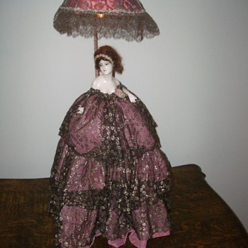 Doll with light in parasol