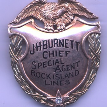 14K gold presentation badge belonging to Rock Island Railroad Chief Special Agent John H. Burnett
