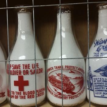 Milk Bottles containing Red Cross Slogans......