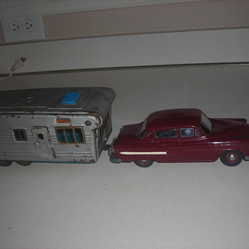 Model cars built when I was a kid & promo cars and a tin toy camper.