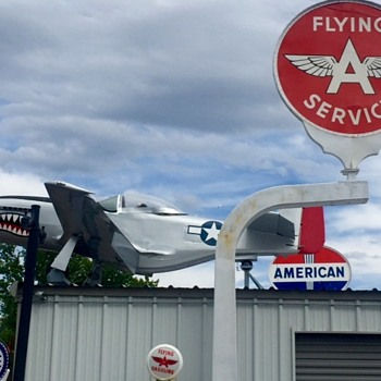 Biggest Service Station Sign Collection in the World has to have a P-51 Mustang!  - Signs