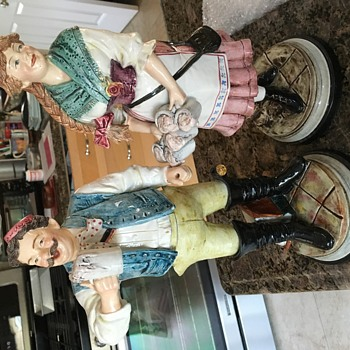 Statues of barmaid and drinker - Breweriana