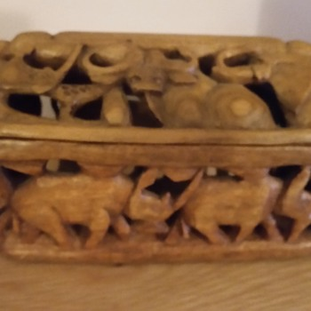 Carved wooden box with holes either end - Folk Art