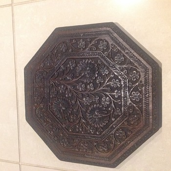 Octagonal carved wooden table