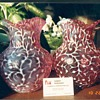 hard to find opalescent cranberry pitchers from the 1800's