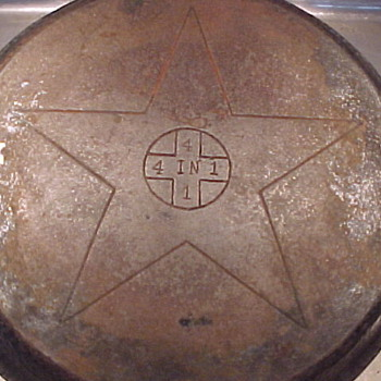 4 in 1 Cast Iron pans. Is this a Griswold set ? Looks like the Griswold cross inside a large star ?
