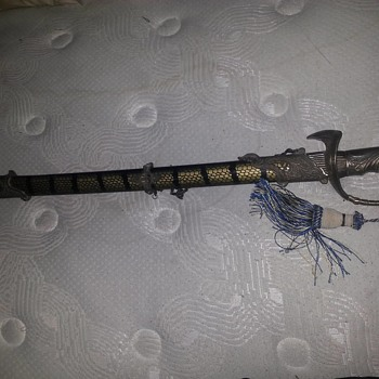 Sword that I have no clues name? Help?