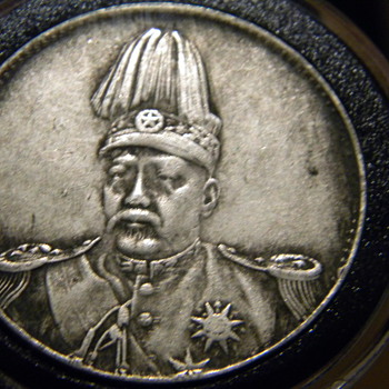 General and Dragon?  Chinese silver dollar