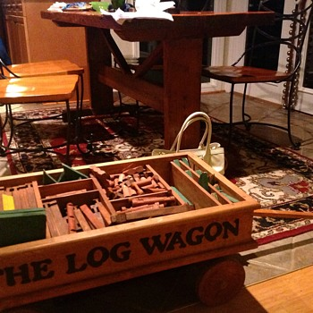 The Log Wagon with Lincoln logs and other not sure what kind